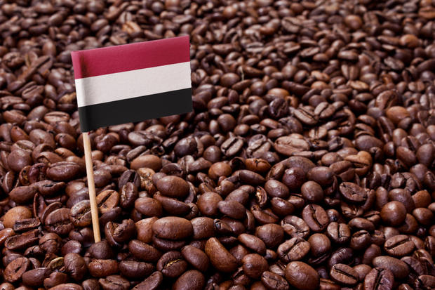 Flag of Yemen sticking in coffee beans.(series)